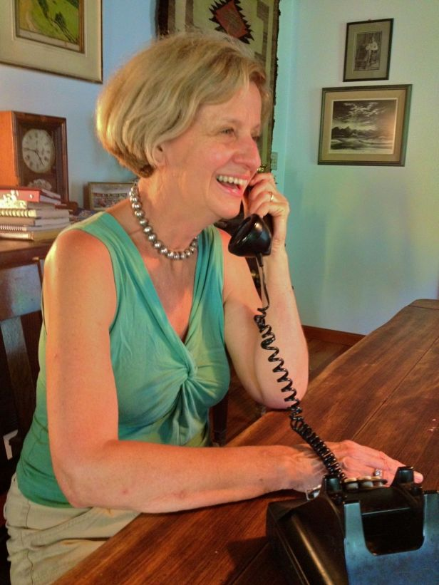 Julie Fisher, giving a radio interview by phone